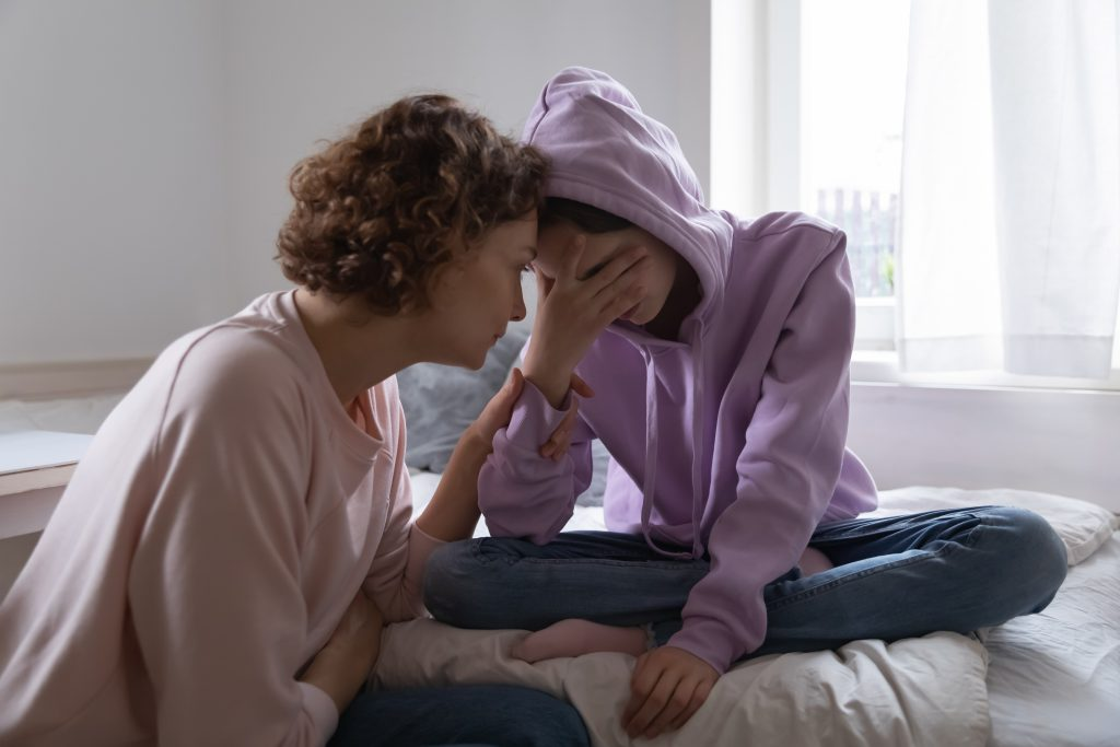 A mother has a hard talk with her daughter.