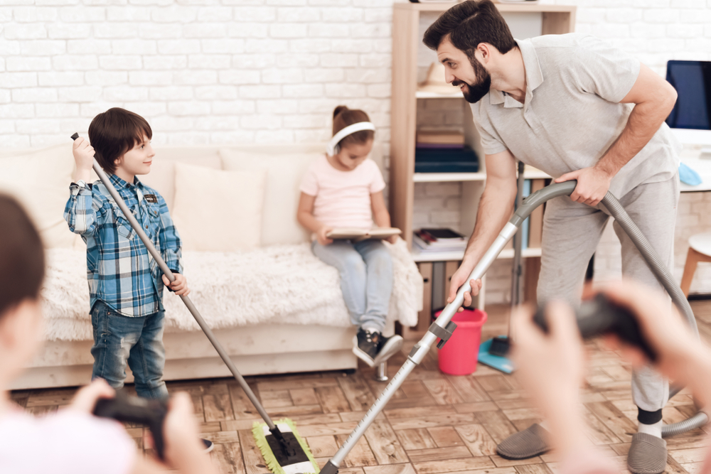 A family cleans their house together.