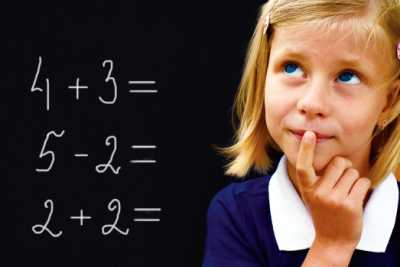 Girl solving math problems